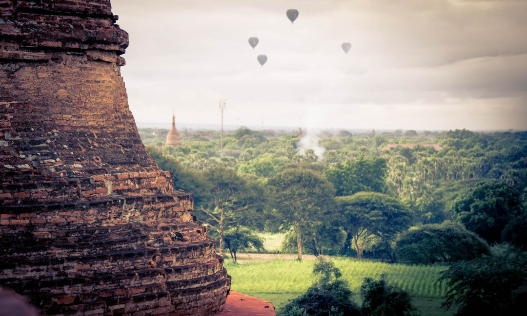 Hot Air baloons in distance beside pagoda