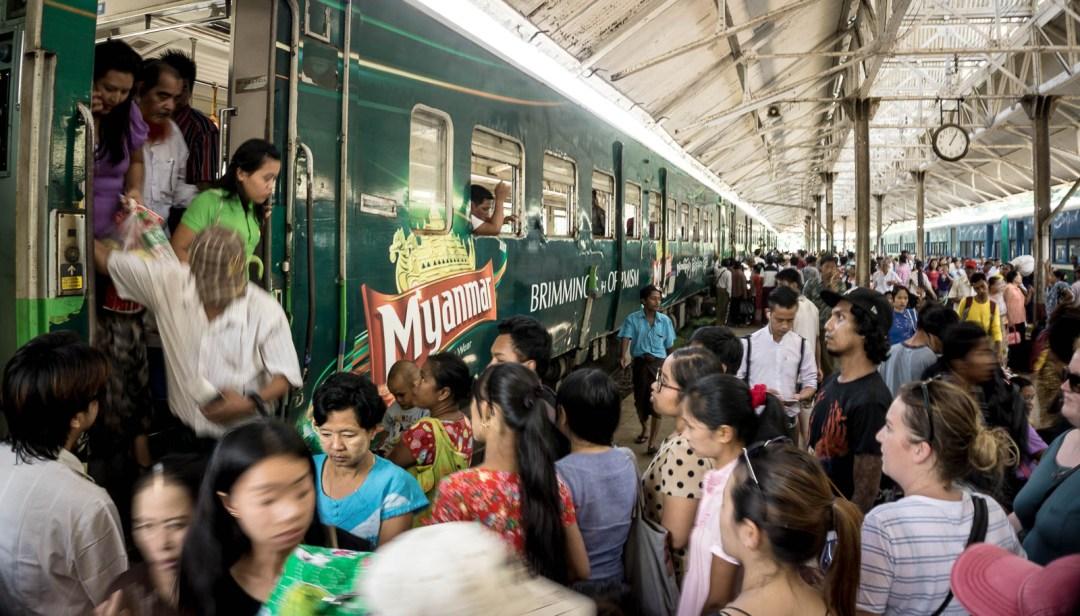 Passengers climbing off of circular train