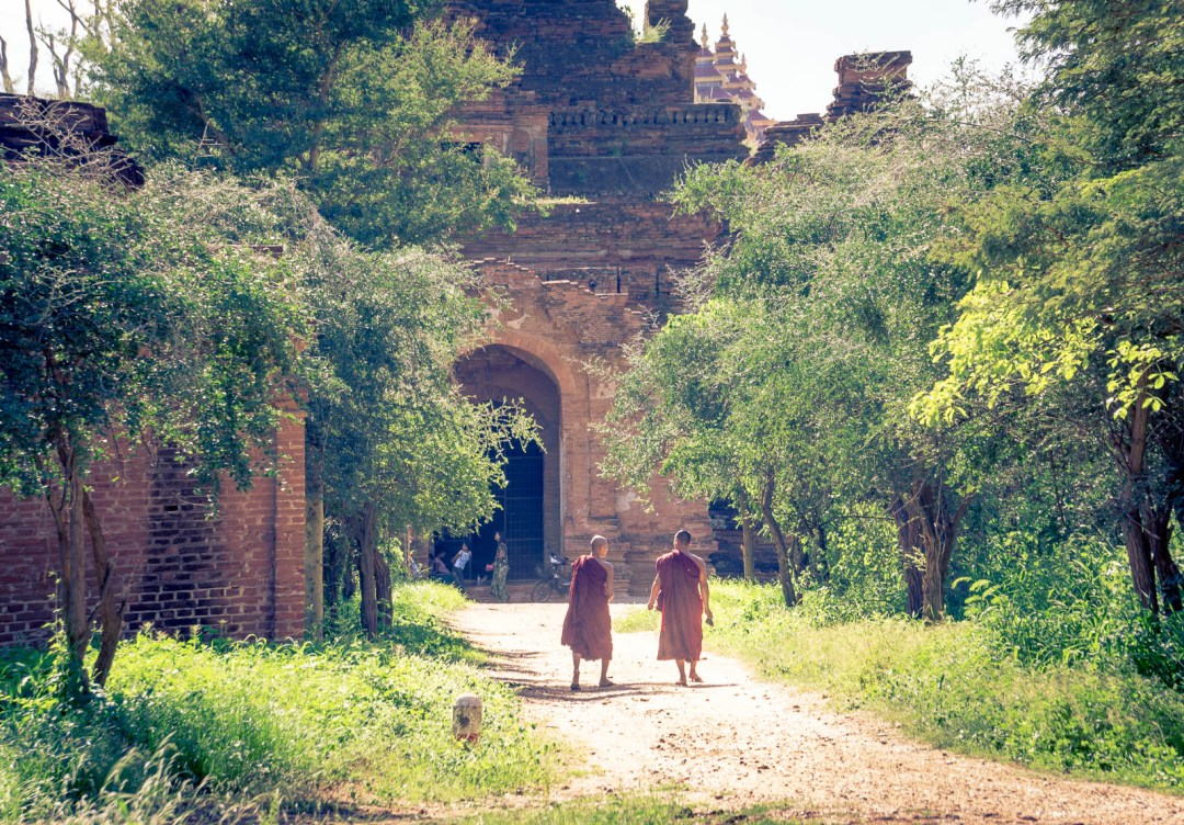 Two Buddhist monks walking towards temple