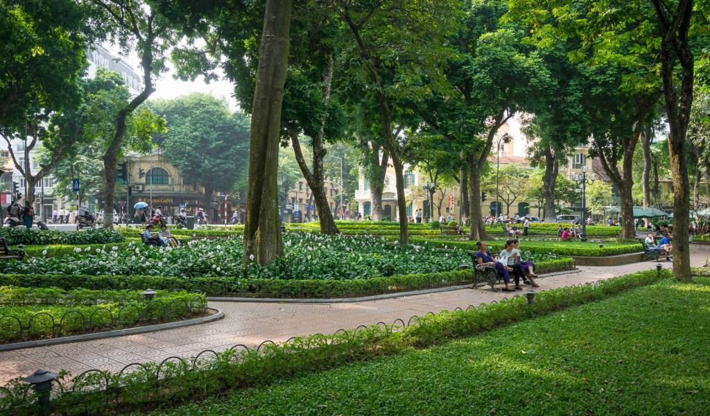 Green park on edge of lake in Hanoi