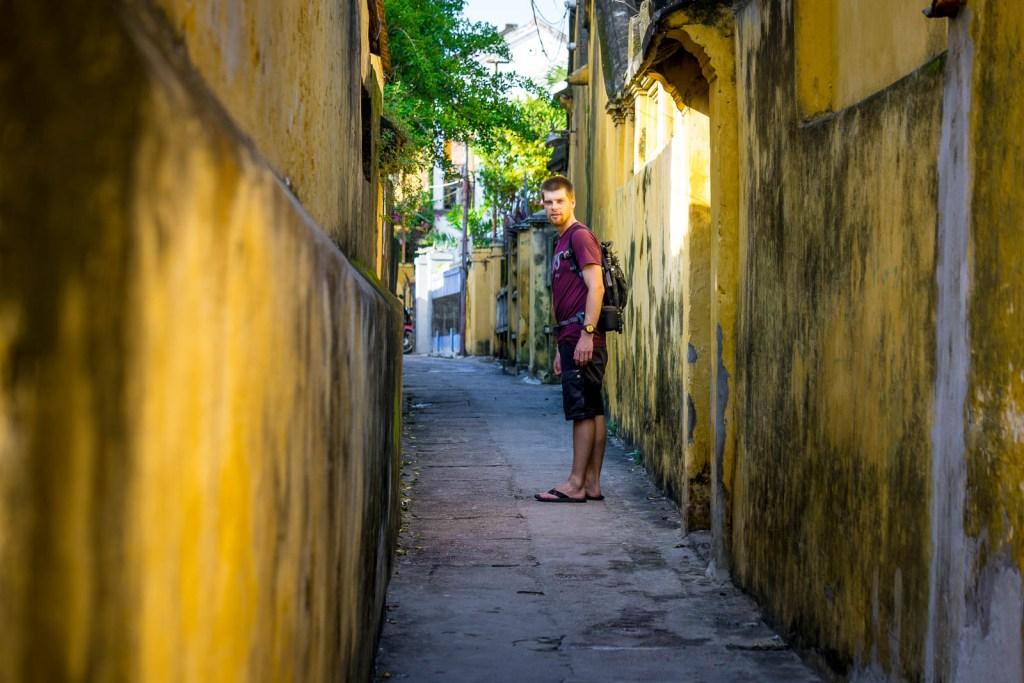 Narrow alleyway with yellow walls