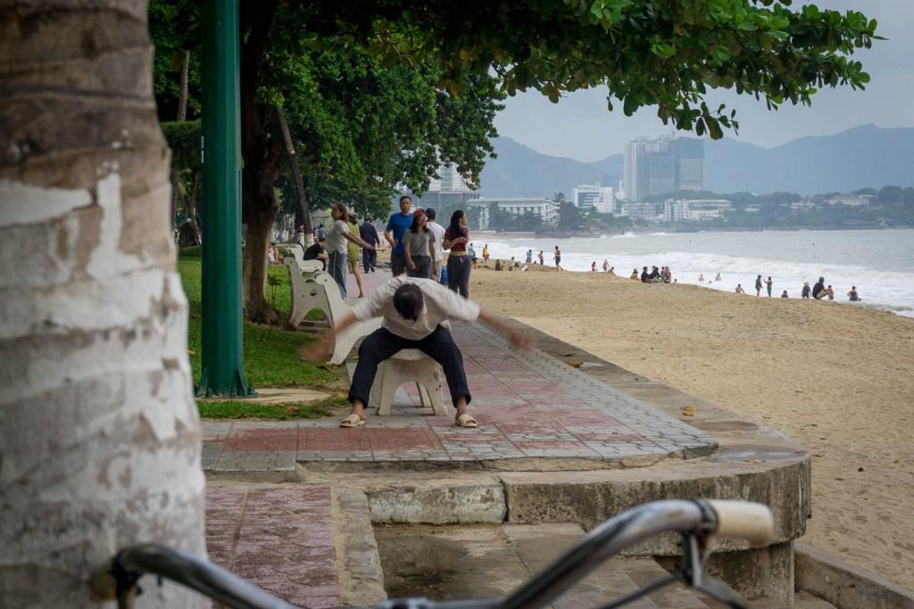 Vietnamese man excercising on beach