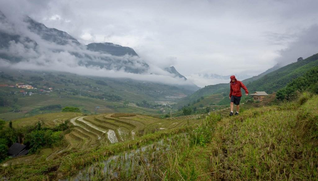 Walking along edge of rice terrace in Sapa