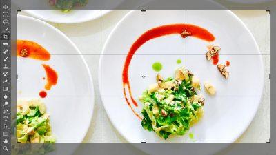 Captura de una fotografía con platos de comida siendo recortada en Adobe Photoshop