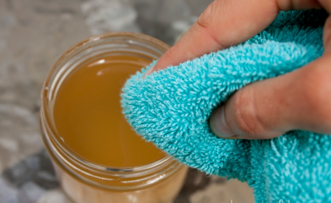 Applying diluted apple cider vinegar solution to skin