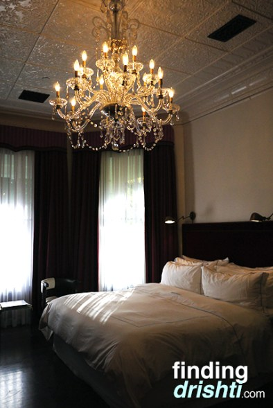 Giant comfy bed and chandelier