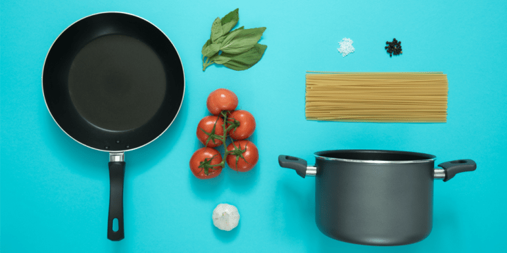 An aerial image of a pot, pan, tomatoes, garlic, uncooked spaghetti, basil leaves, salt and pepper displayed neatly on a bright turquoise background to metaphorically illustrate collected modalities for a treatment plan like collecting ingredients for a recipe.