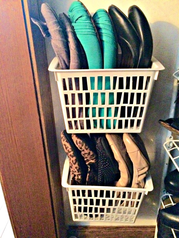 Dollar store baskets nailed to closet wall for flats and flip flops storage.  Genius!