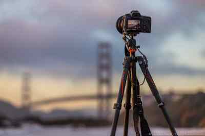 An image of a camera on a tripod taking a photo