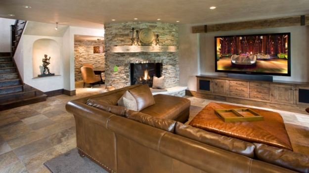 A rustic basement with fireplace