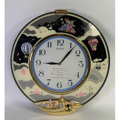 """SEIKO """"Melodies In Motion"""" Oval Clock QXM114NRH"""