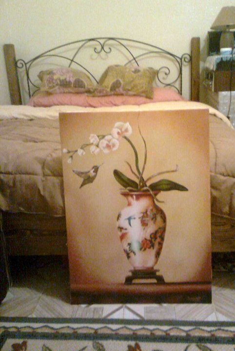 flying hummingbird and orchids with vase still life