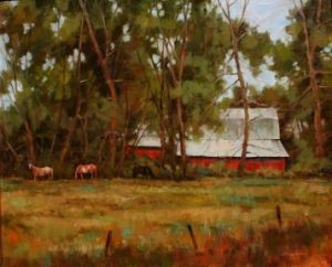 red barn and horses grazing in wyoming