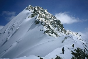 snow mountain climbing on a ridge