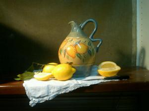 old italian pitcher with lemons
