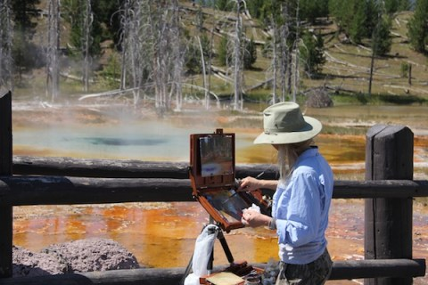 artist painting in yellowstone
