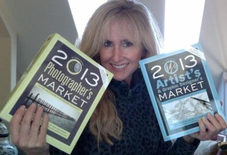 lori mcnee holding artists & graphic designer's market and photographer's market books