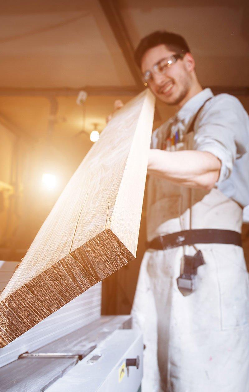 woodworker inspecting board