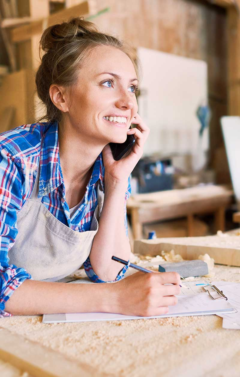 woodworker taking an order on the phone