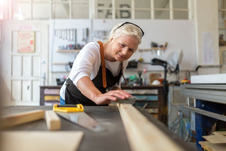 smiling senior woman in workshop