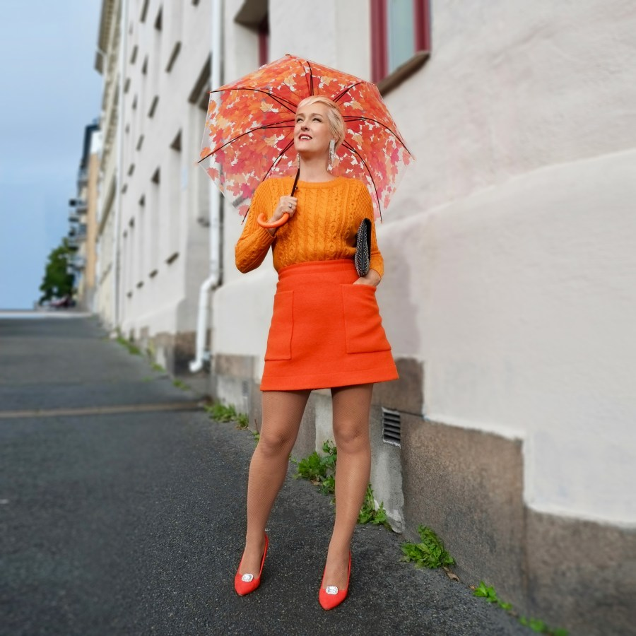This image has an empty alt attribute; its file name is all_orange_outfit_standing_fineforforty-1024x1024.jpg
