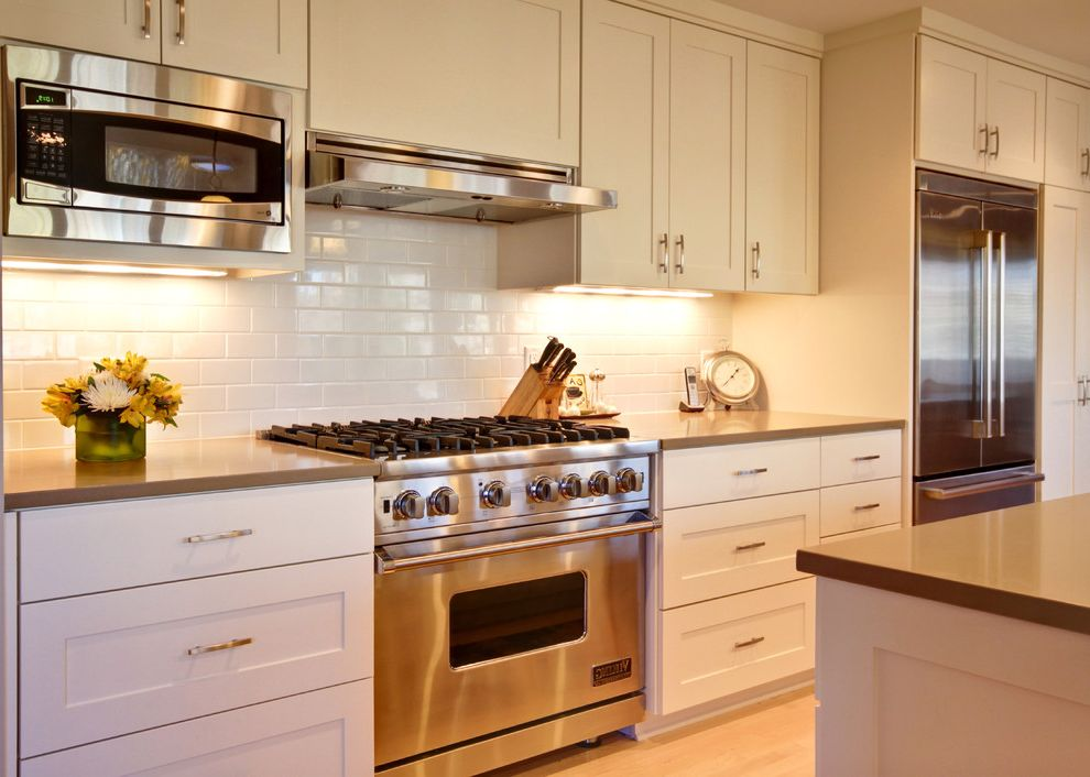 Above Range Microwave With Eclectic Kitchen And Backsplash