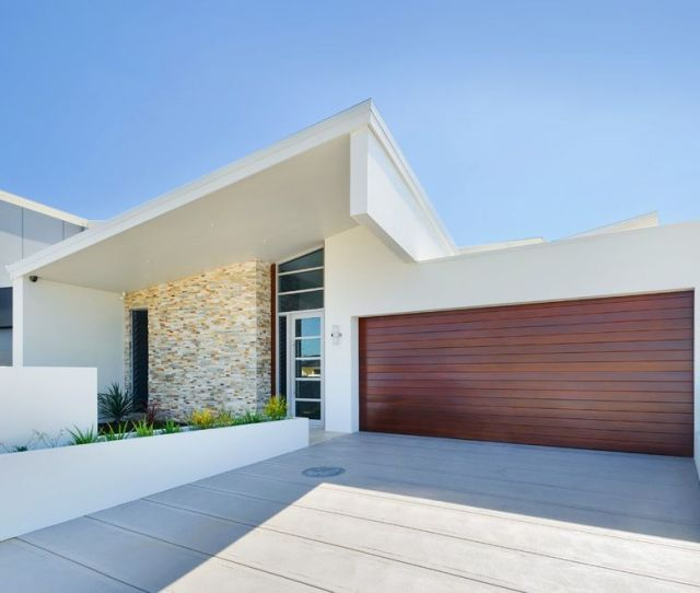 Concrete Driveway Contemporary Exterior Also Concrete Driveway Covered Entry Curb Appeal Exterior Lighting Mixed Roofline Planters Roofline Stone Wall