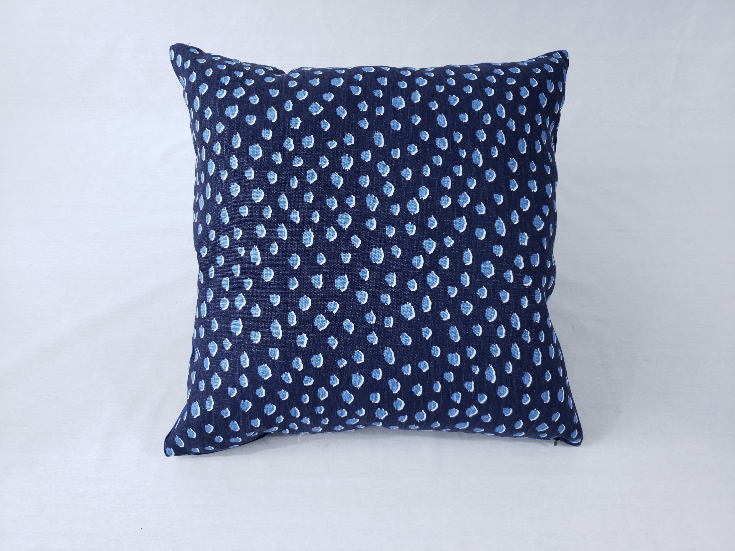 A kate spade blue polkadot cushion