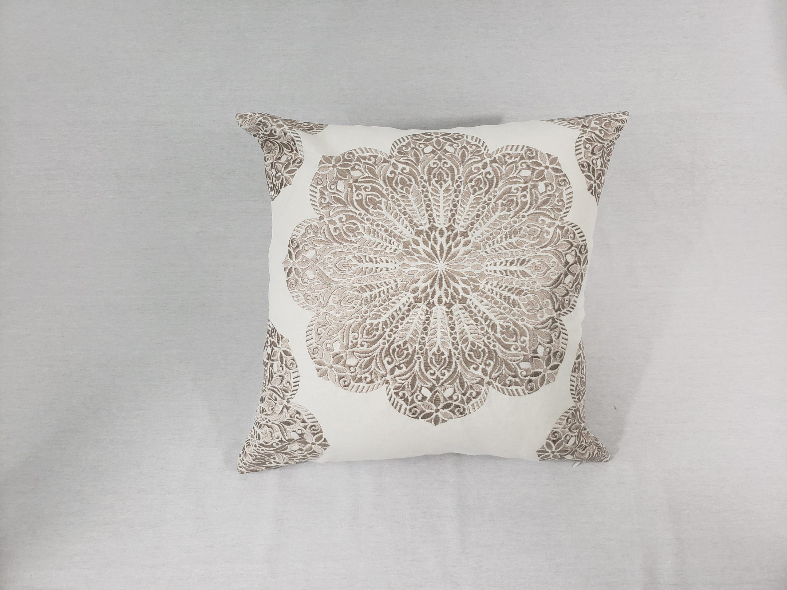 Floral medallion cushion with white background