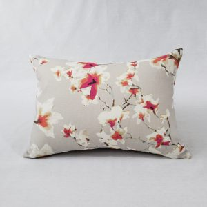 A modern floral cushion in pink & beige