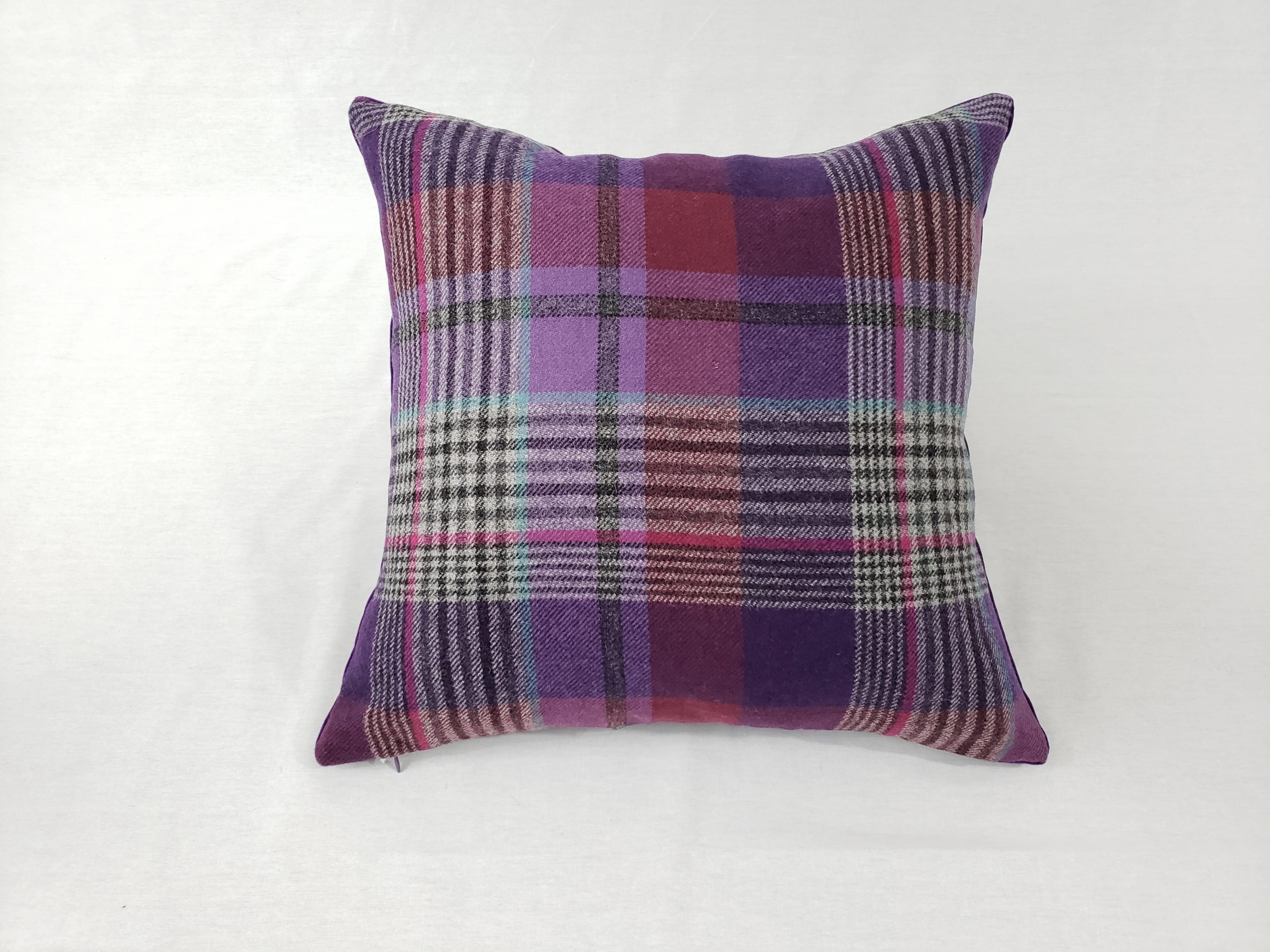 A multicolor wool plaid patterned cushion