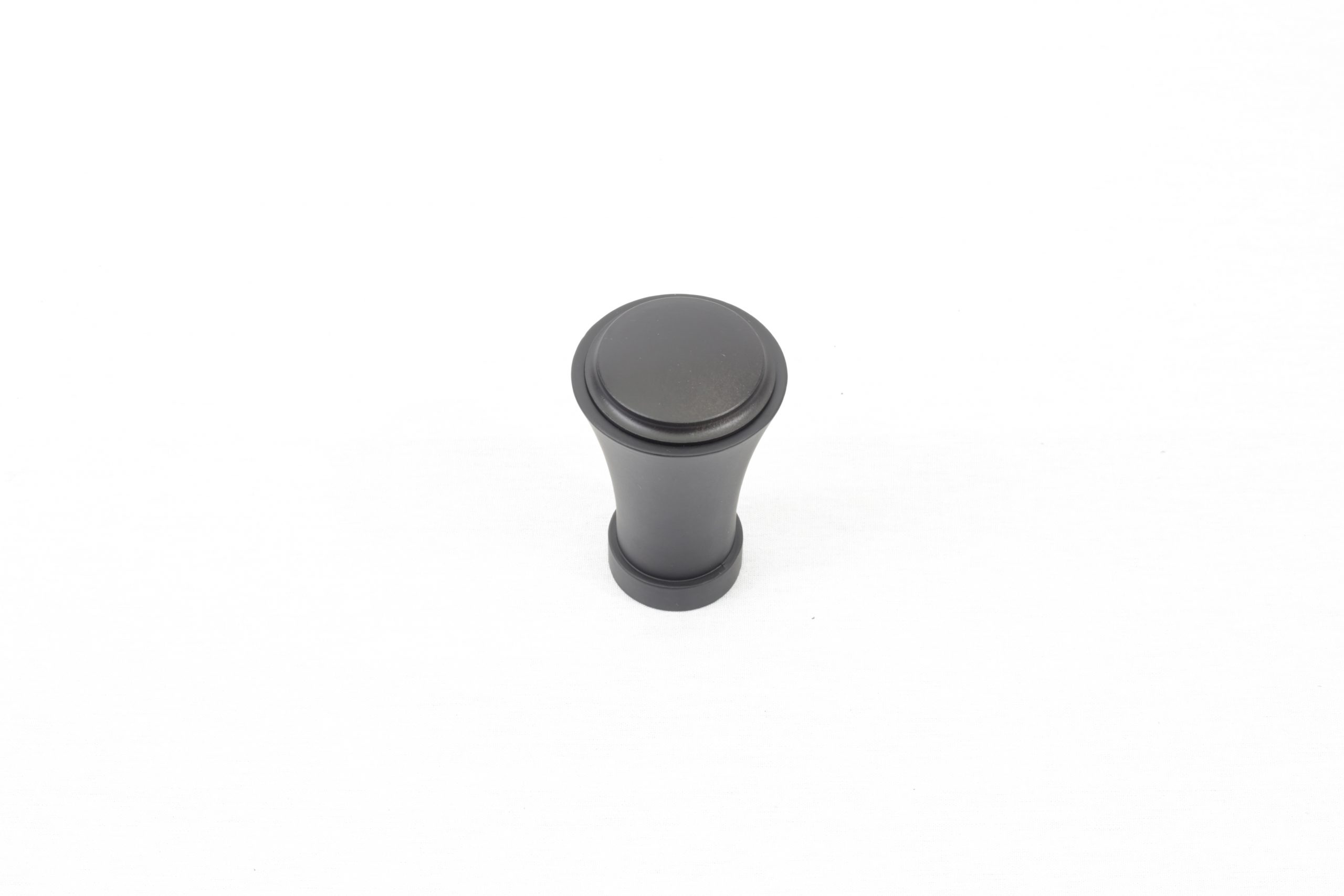 A black contemporary drapery rod finial