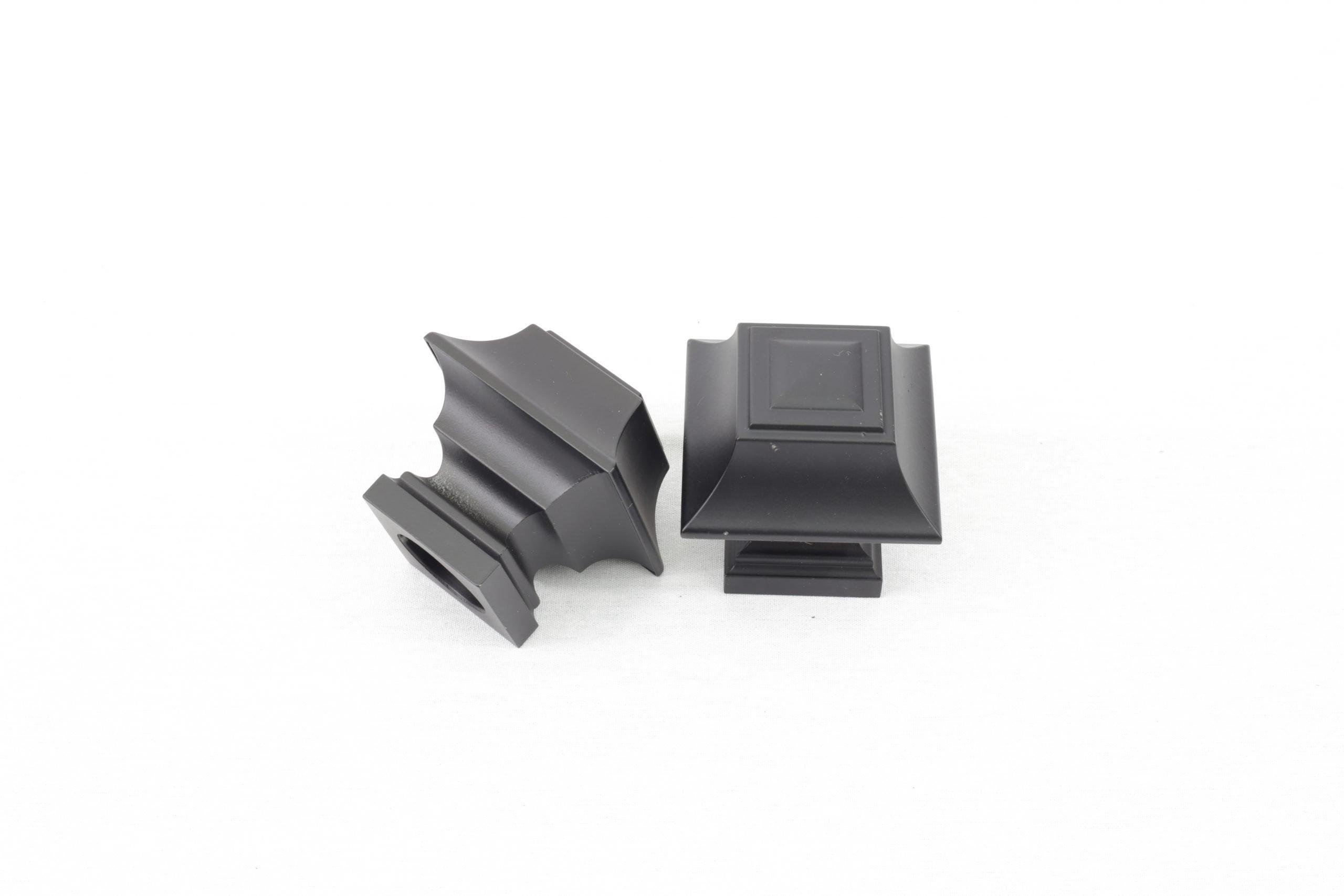 A decorative drapery hex finial in black