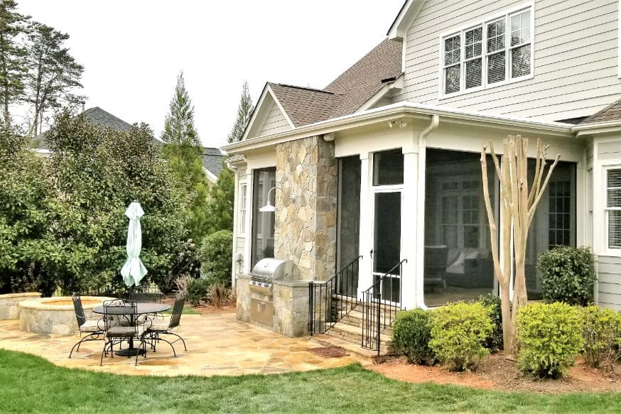 screened porch with outdoor patio and