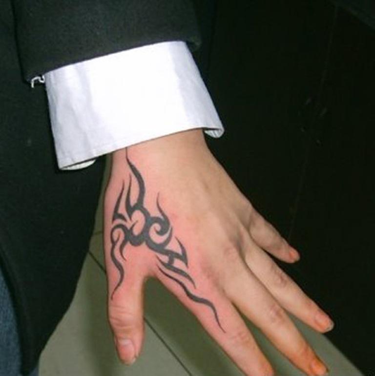 Side Hand Giraffe Small Tattoo