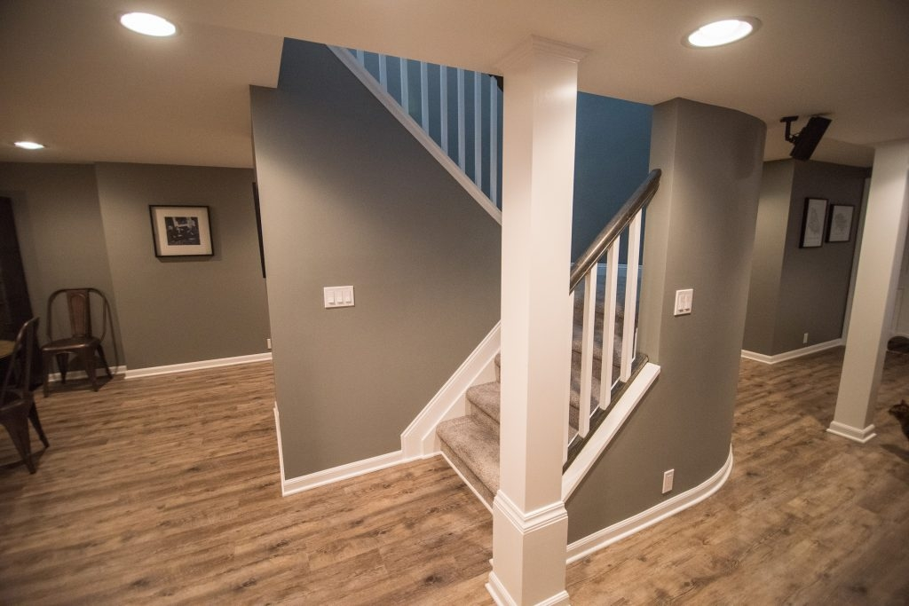Franklin Mi Basement Remodel Rustic Industrial Design By Fbp   Basement With Stairs In Middle   Upper Level Basement   Family Room   Hidden Basement   Underground Washroom   Middle Hallway