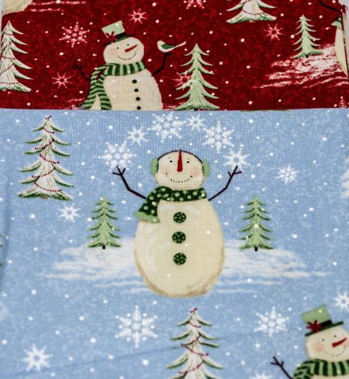 snowmen on christmas fabric in blue and red