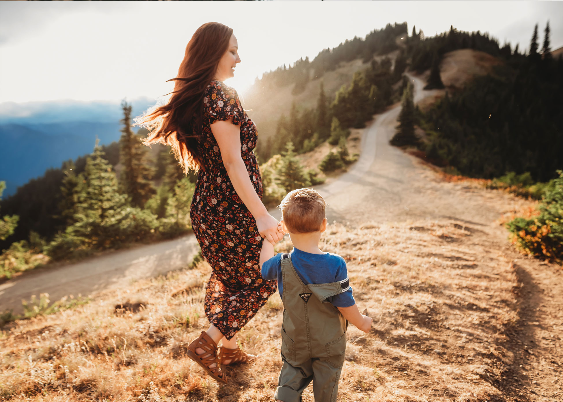 mom and son in mountain sunset