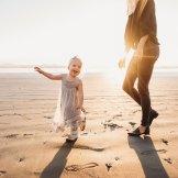 mom and daughter playing at the washington coast