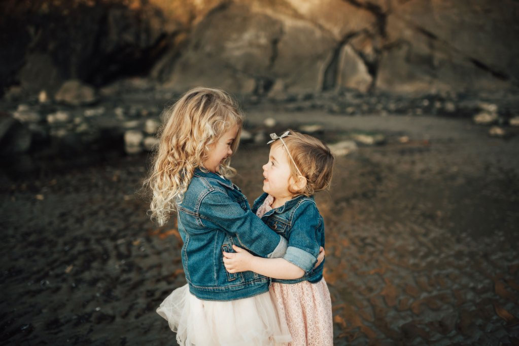 two little girls laughing at salt creek recreation area