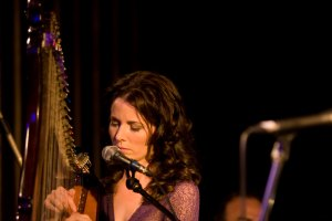 Fionnuala Gill playing harp at the launch of her album in Dublin