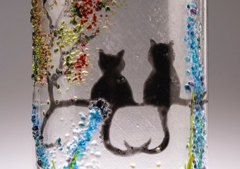 2 cats with entwined tails on tree branch light curve