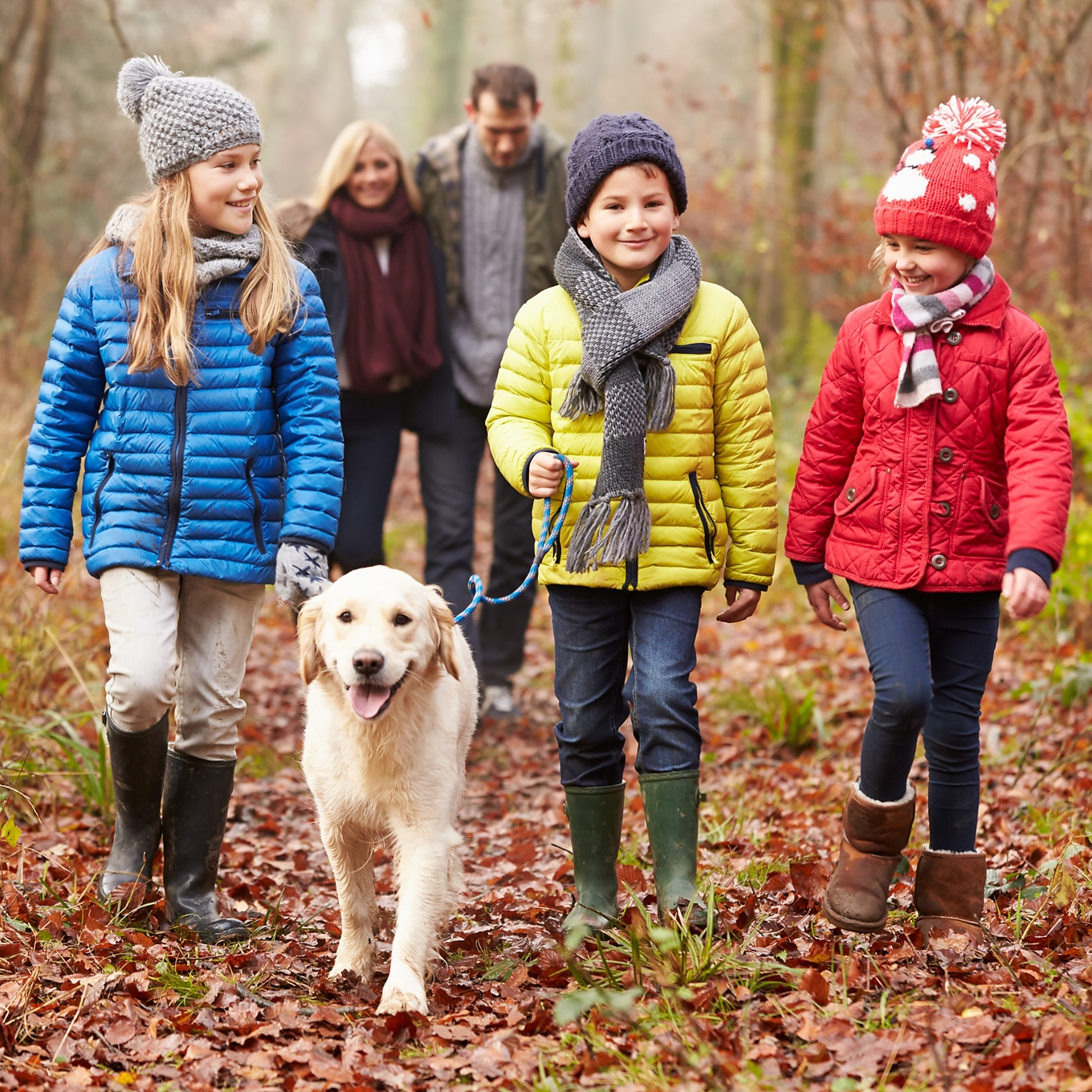 Happy Family Enjoying a Nature Walk with Dog