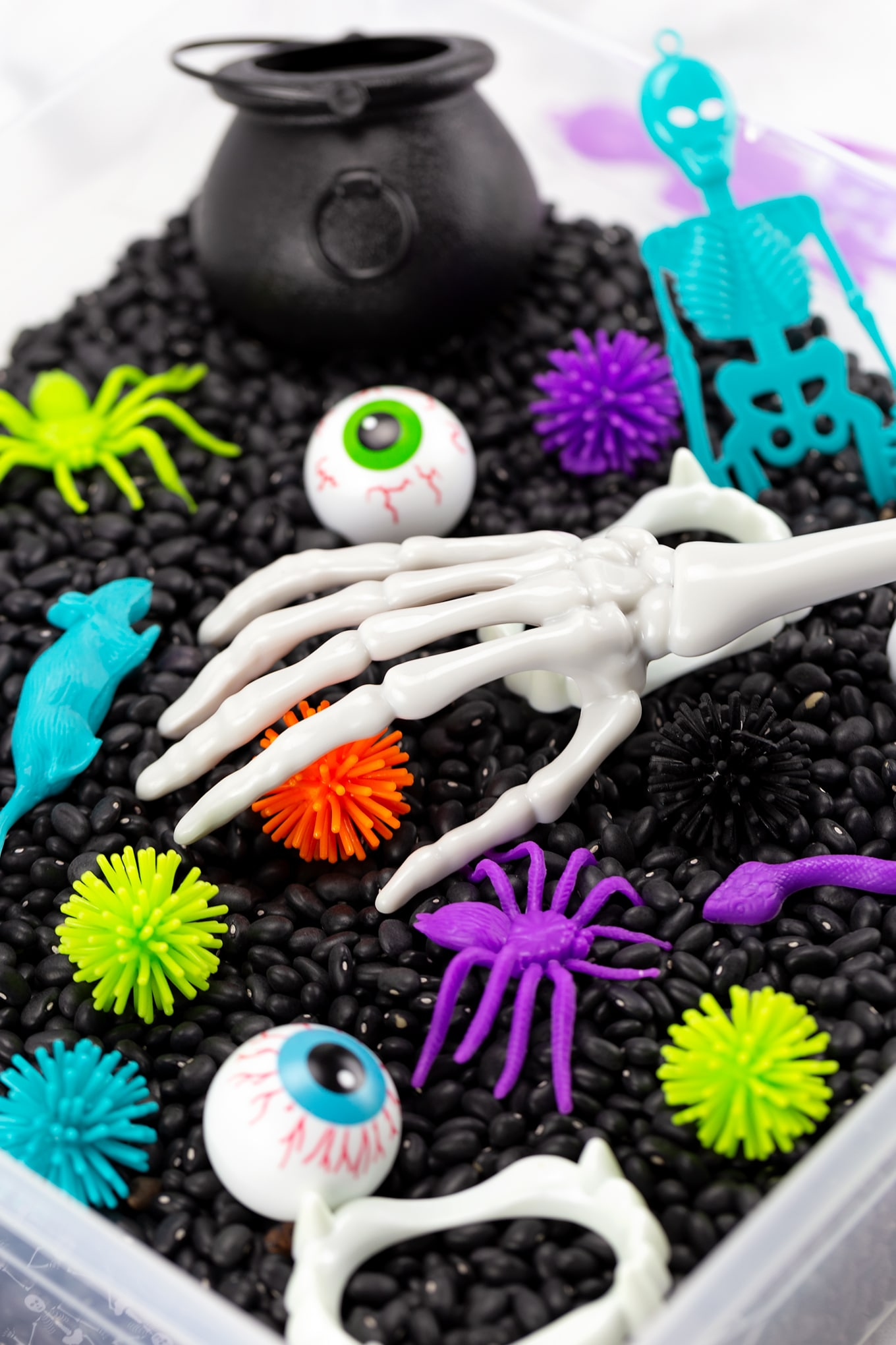 Halloween Sensory Bin with Skeleton Tongs