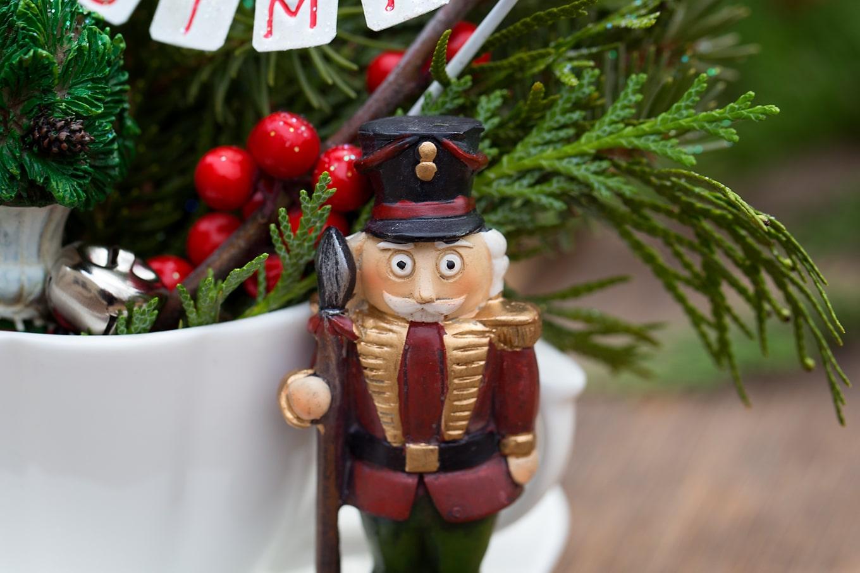 Resin Nutcracker in Christmas Teacup Garden