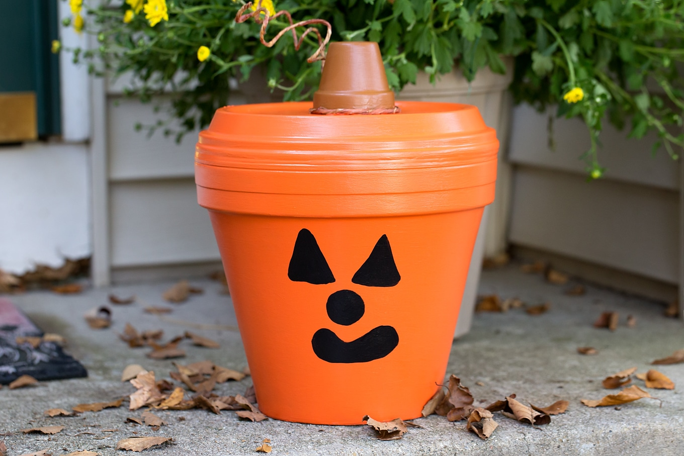 Bring a little Halloween fun to your garden, patio, or porch with this easyTerracotta Pot Jack O'Lantern Craft. It's a fun Halloween craft for kids!