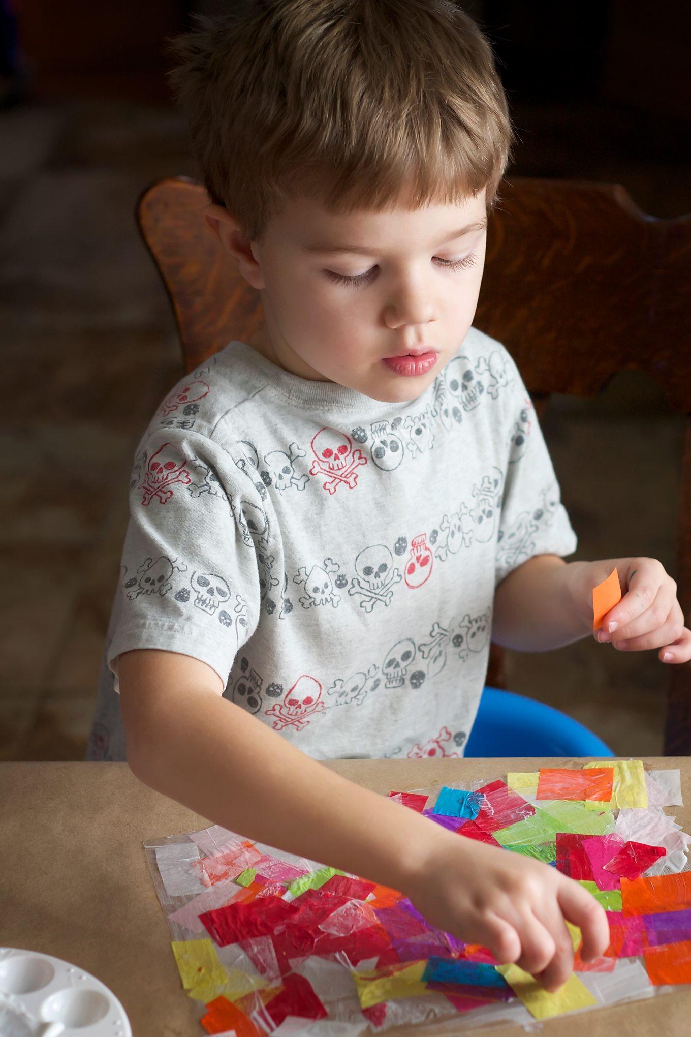 Child Making Rainbow Heart Suncatchers