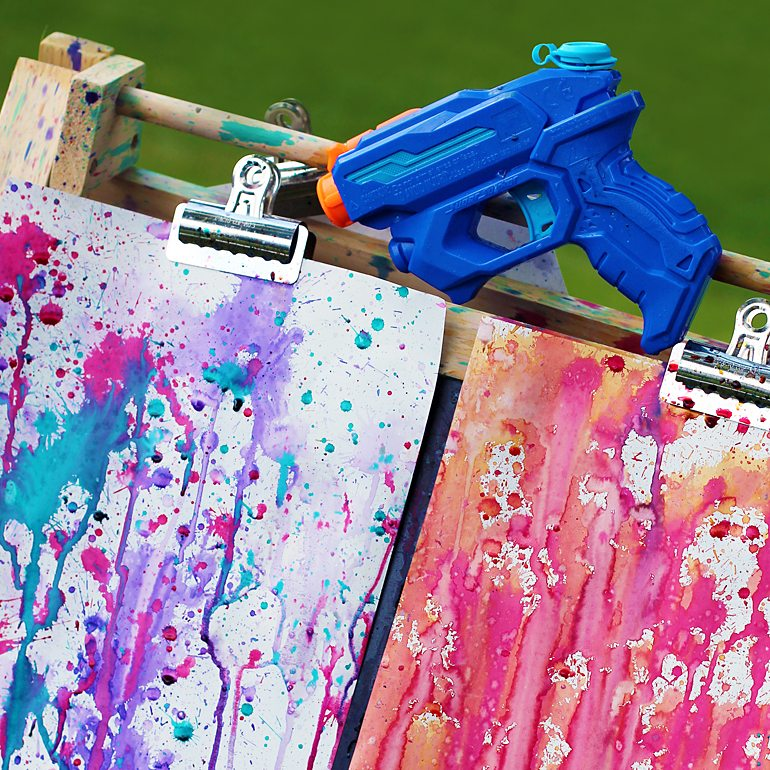 Colorful Backyard Squirt Gun Painting Kids Art Project via Fireflies and Mud Pies