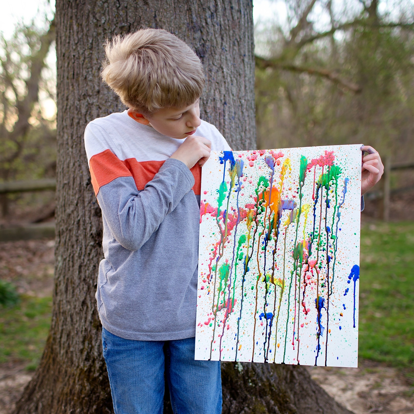 Boy Holding Squirt Painting