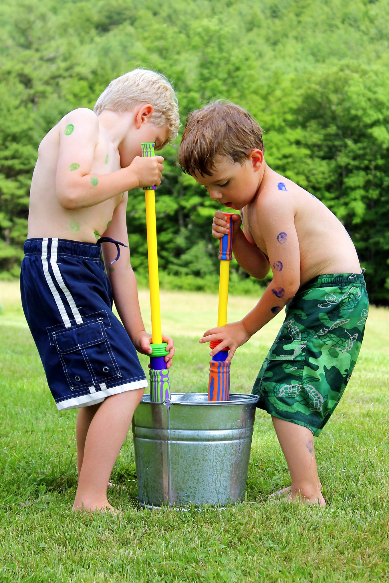 Two Children Playing with Water Blasters